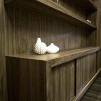 modern office built in wall unit features floating shelves and a built in credenza. finish is clear lacquer on sequenced american walnut