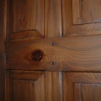 shown is one of 20 antiqued cypress doors, custom made for a residence in St. Petersburg, FL The doors are constructed of solid cypress, mortise and tenon construction, with square pegs at the joints. The finish work began with heavy distressing of the wood, followed by a dark stain and glaze.